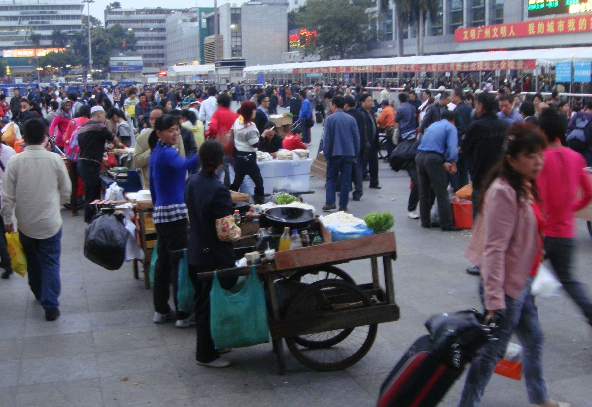 Street vendors in the square of Guangzhou Railway Station