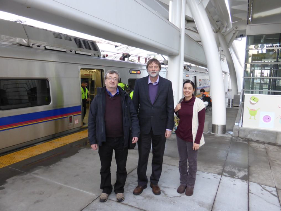 Photo of authors at the RTD A Line commuter rail at Union Station in Denver, CO USA